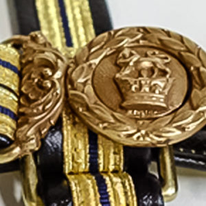 Buckles and hardware were cast from originals obtained from antiquities dealers and military experts in Great Britain. the authentic gold ribbon and braid contained real gold. Officers and enlisted sailors sword belts made by gbb Leather.
